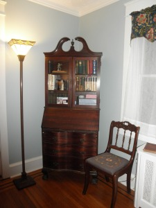 secretary with antique books, purchased and already owned